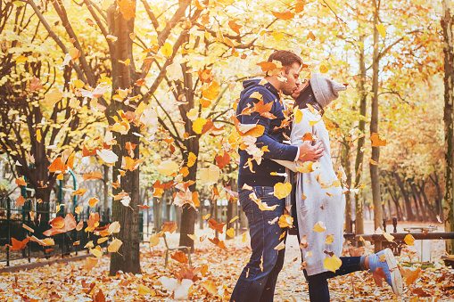 autumn love, couple kissing in fall park, happy man and woman