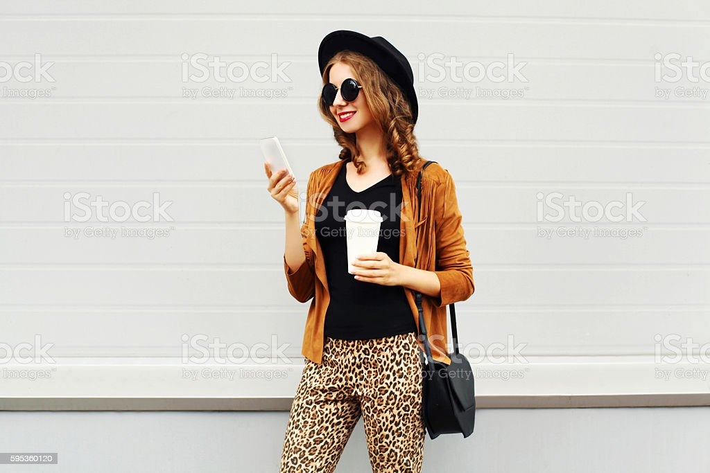 Autumn luxury pretty woman, coffee cup, smartphone walking in city - foto de stock