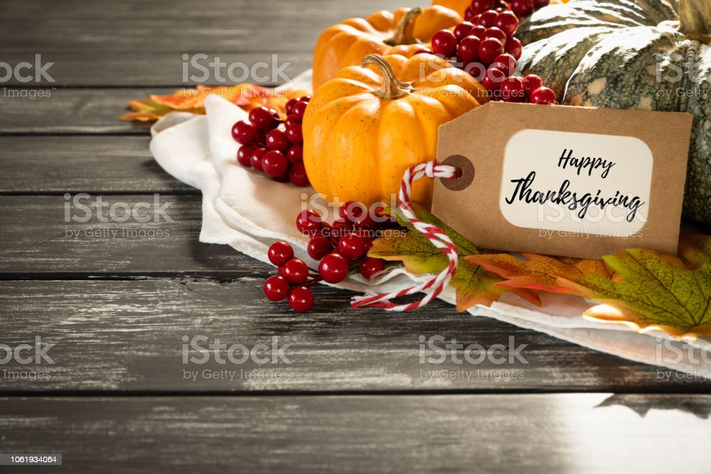 Autumn maple leaves with Pumpkin and red berries on old wooden backgound. Thanksgiving day concept. - Zbiór zdjęć royalty-free (Centralna ozdoba)