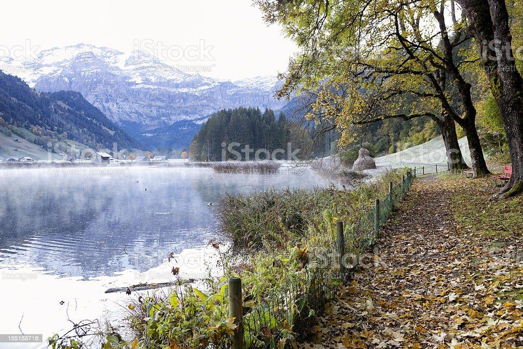 Autumn Mist rises from the Lenkerseeli lake in Lenk stock photo