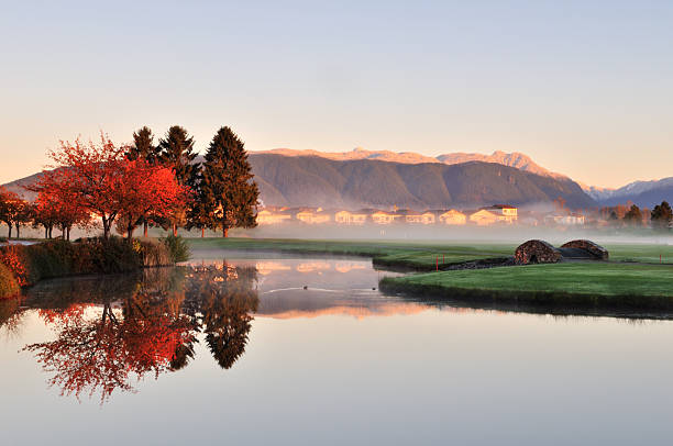 autumn morning in golf course stock photo