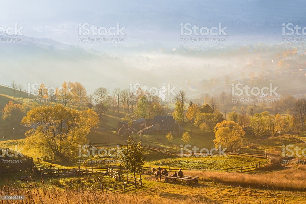 autumn morning in mountain village stock photo