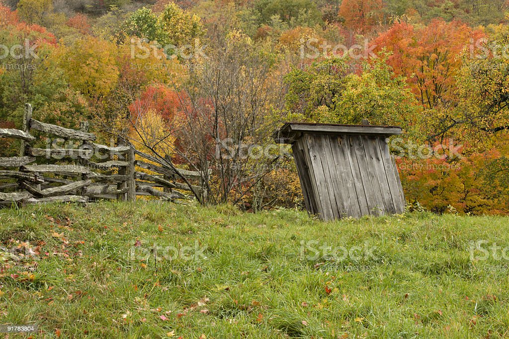 Autumn Mountains and Leaning Outhouse royalty-free stock photo