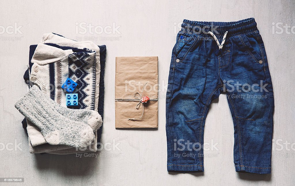 Autumn or winter children's outfit clothes. stock photo