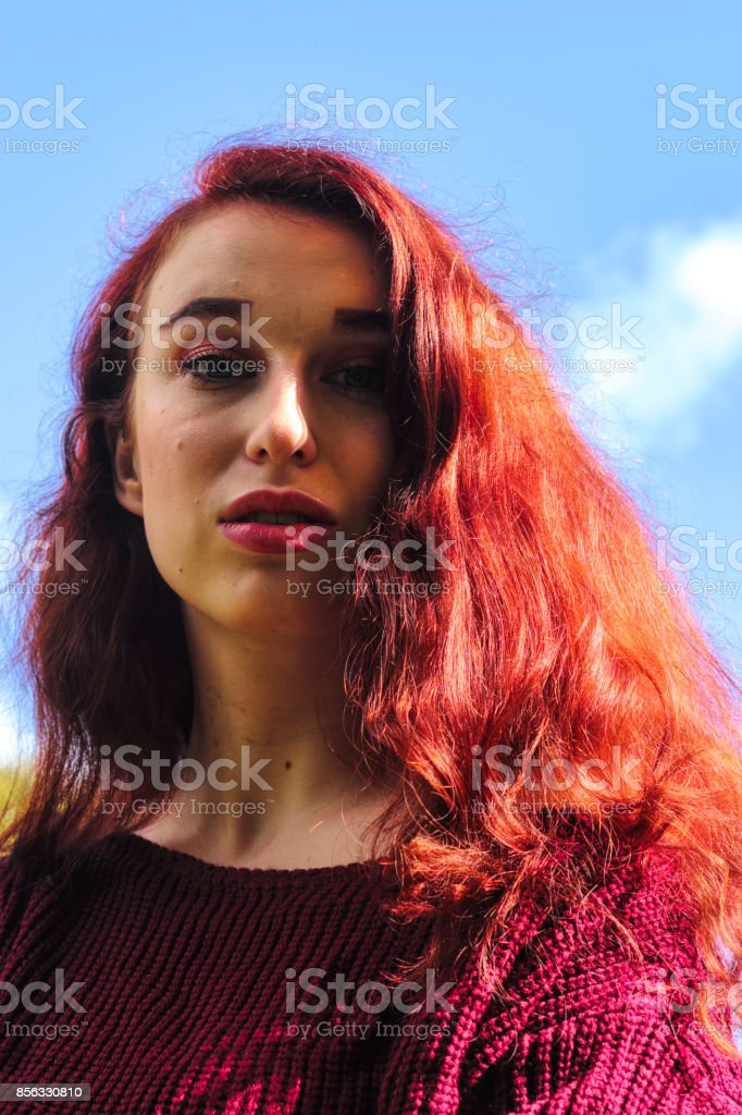 Autumn outdoor girl redhead long hair headshot stock photo