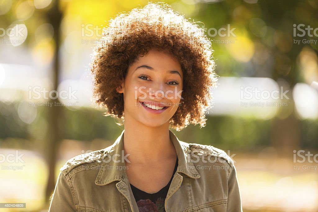 Autumn outdoor portrait of a African American young woman stock photo