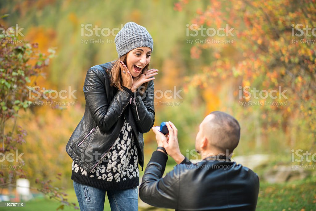 Autumn outdoor wedding proposal engagement stock photo
