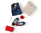 istock Autumn outfit. Women's fashion clothes and accessories in blue and red colors isolated on white background. Flat lay, top view. 837336346