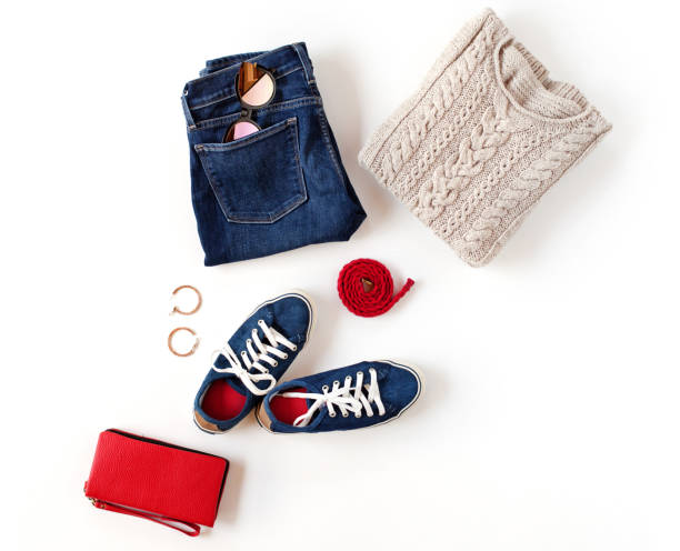 Autumn outfit. Women's fashion clothes and accessories in blue and red colors isolated on white background. Flat lay, top view. stock photo