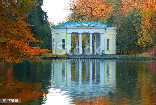 istock Autumn park lake scene 524775491