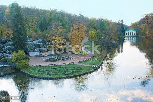 istock Autumn park lake wide scene 524775501