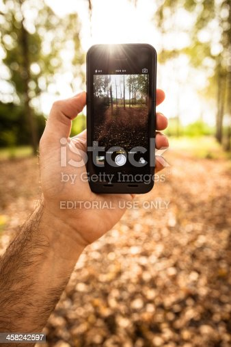 599114758 istock photo autumn park recorded with the new IOS 7 camera 458242597