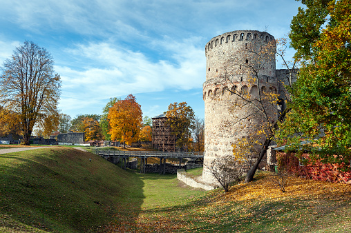 Autumn park with ruins of old castle in Cesis town, Latvia