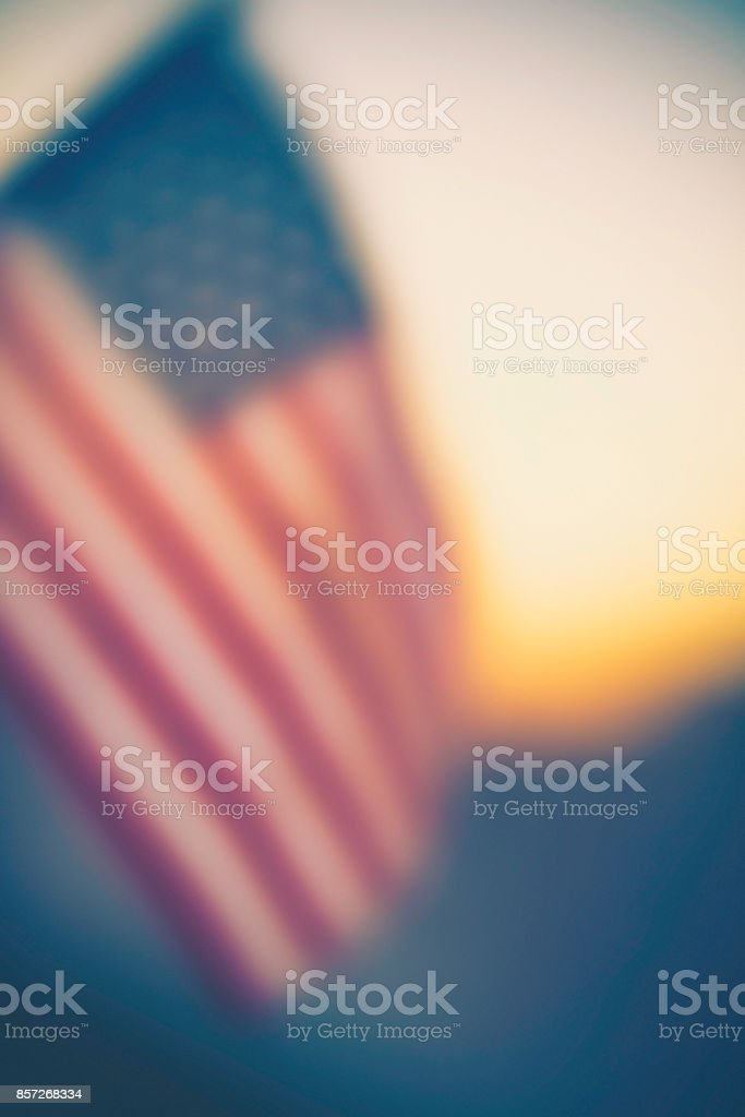 Autumn patriotic background with American flag in sunlight stock photo