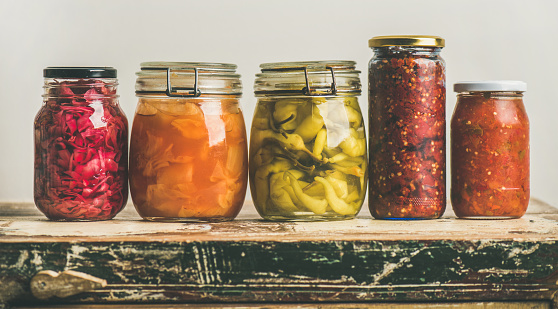 istock Autumn pickled colorful vegetables in jars placed in line 860309510