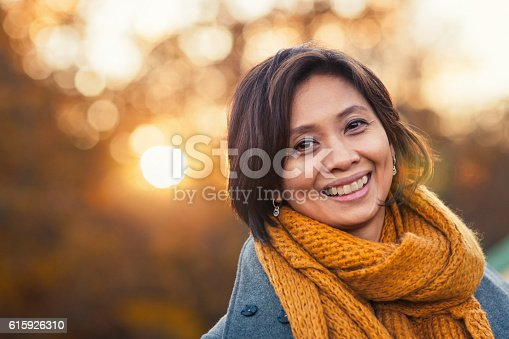 istock Autumn portrait of a woman 615926310