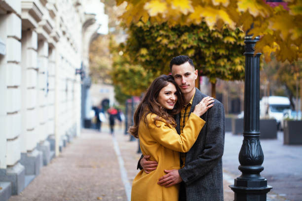 Autumn portrait of a young couple stock photo