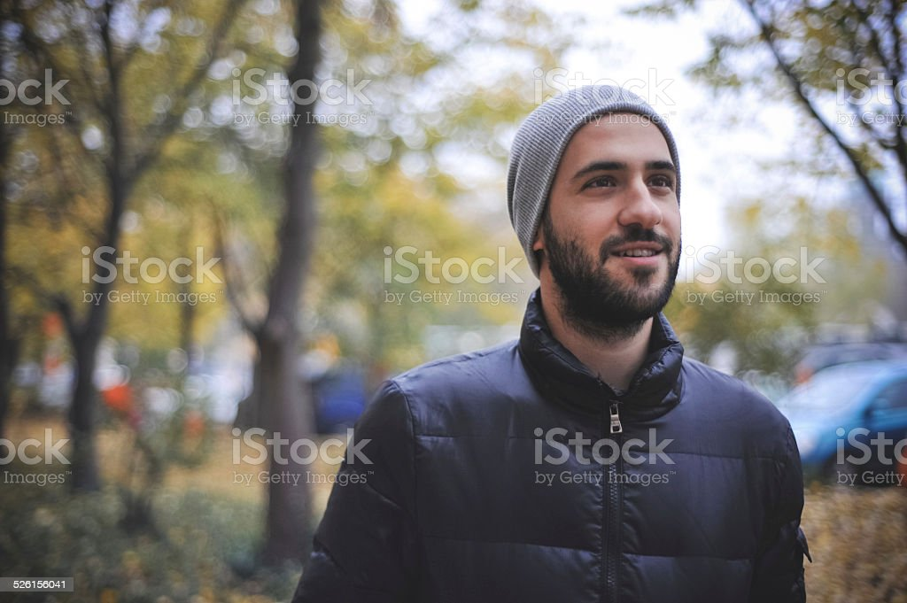 Autumn Portrait of a young man in park royalty-free stock photo