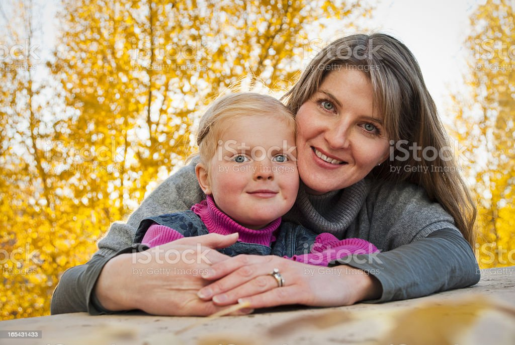 Autumn portrait of mother and daughter royalty-free stock photo