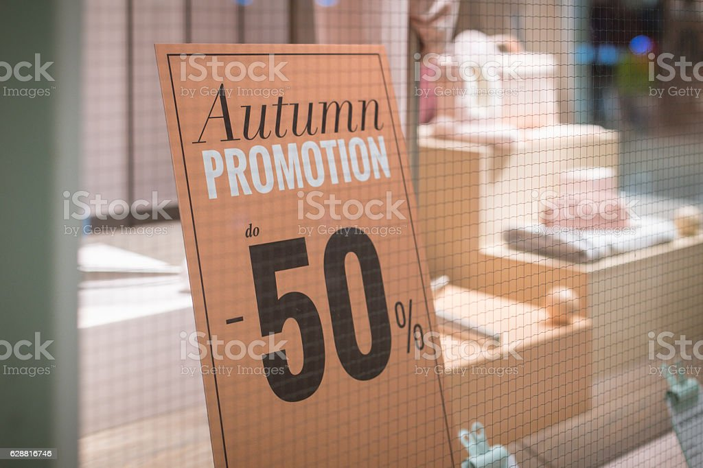 50% autumn promotion - shop window sign stock photo