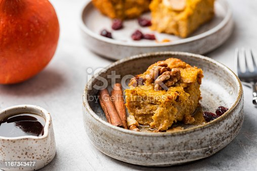 Autumn Pumpkin Pie Cake With Walnuts, Cinnamon, Maple Syrup. Closeup view. Comfort food