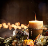 Thanksgiving Autumn Harvest Pumpkin Wreath and Candle on an Old Wood Background