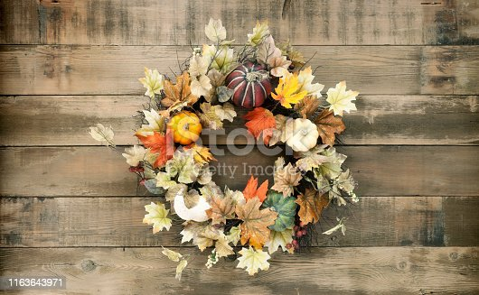 Thanksgiving Autumn Harvest Pumpkin Wreath on an Old Wood Background