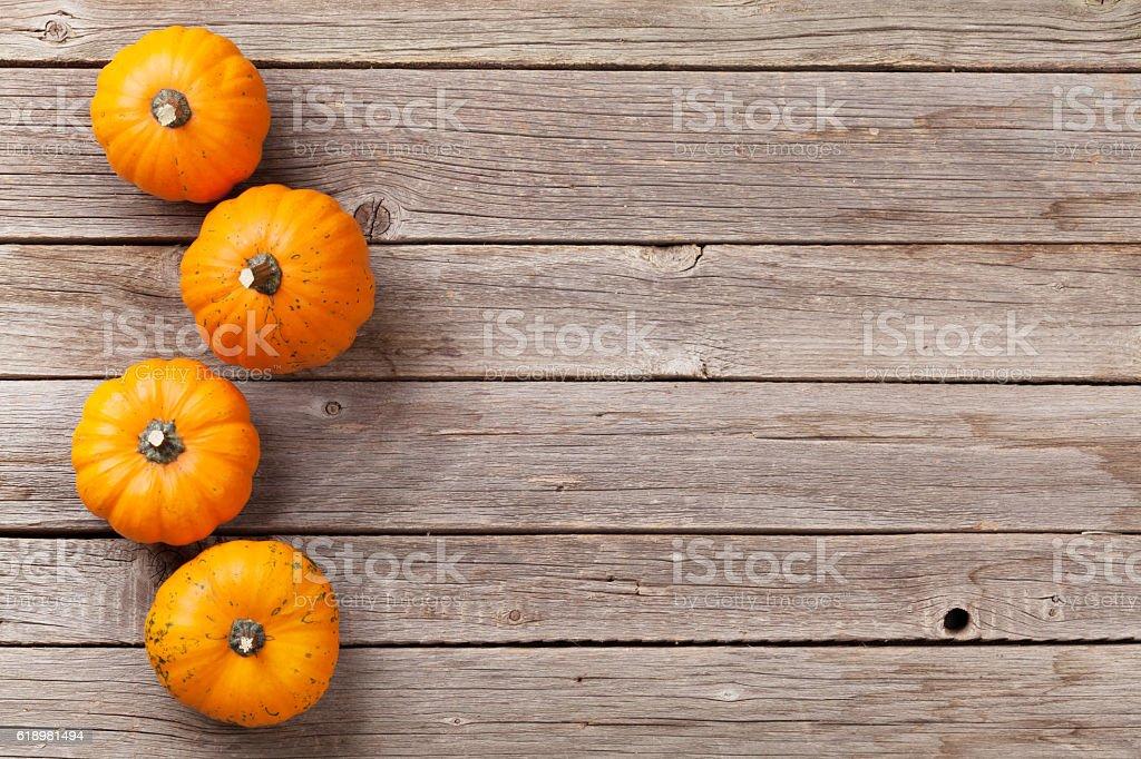 Autumn pumpkins on wooden board table stock photo