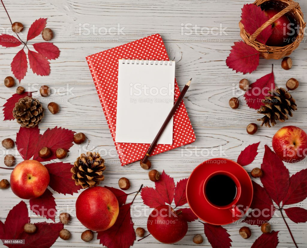 Autumn red leaves with apples on a wooden background. royalty-free stock photo