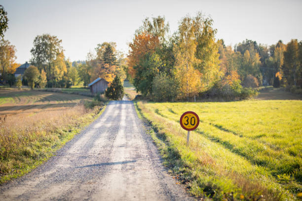 Autumn road in Finland - Speed Limit 30km/h stock photo