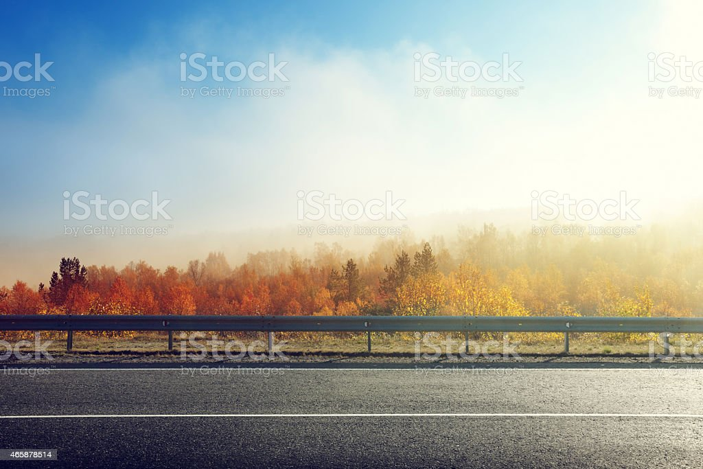 autumn road in sunset time stock photo
