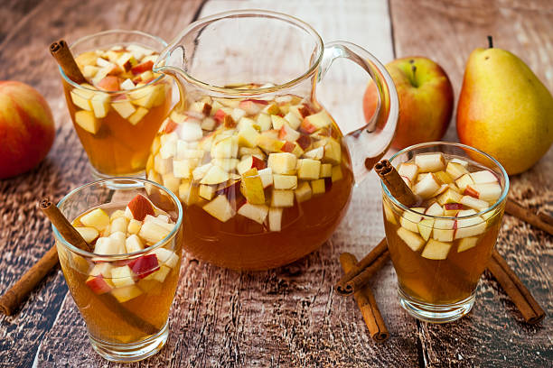 Autumn Sangria Autumn  sangria with apples,pears and cinnamon hot apple cider stock pictures, royalty-free photos & images