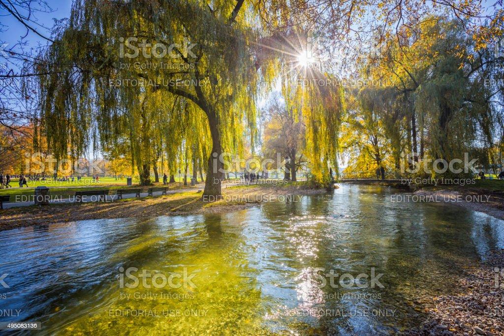 Autumn Scene at eisbach creek in English Garden, Munich, Germany stock photo