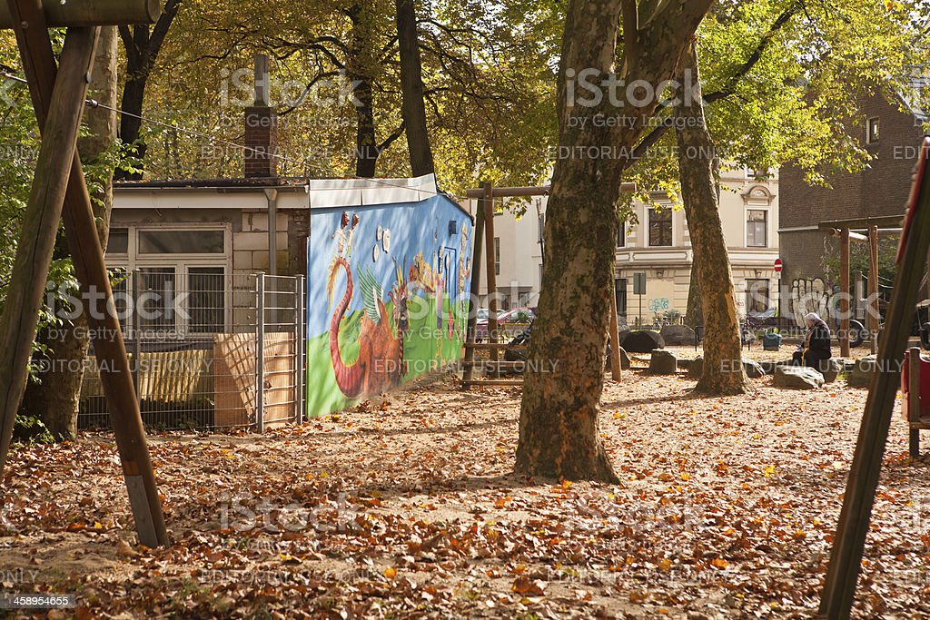 autumn scene on a playground royalty-free stock photo