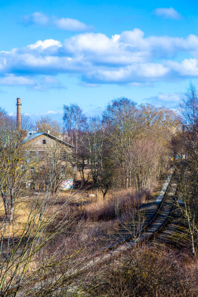 Autumn scene with wooden house and old railway stock photo