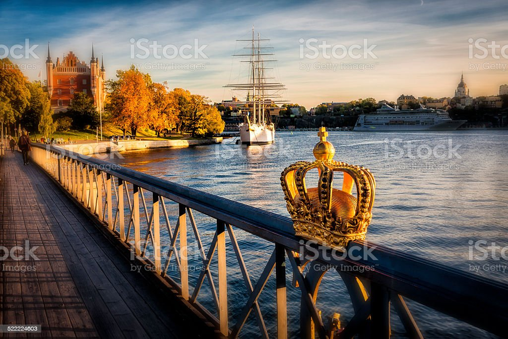 Autumn scenery with crow decorated bridge and sailingship stock photo