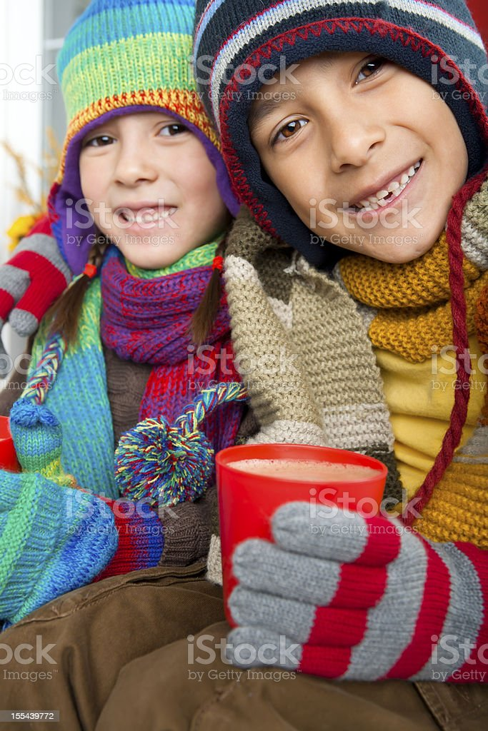 Autumn- Sibling drinking hot chocolate royalty-free stock photo