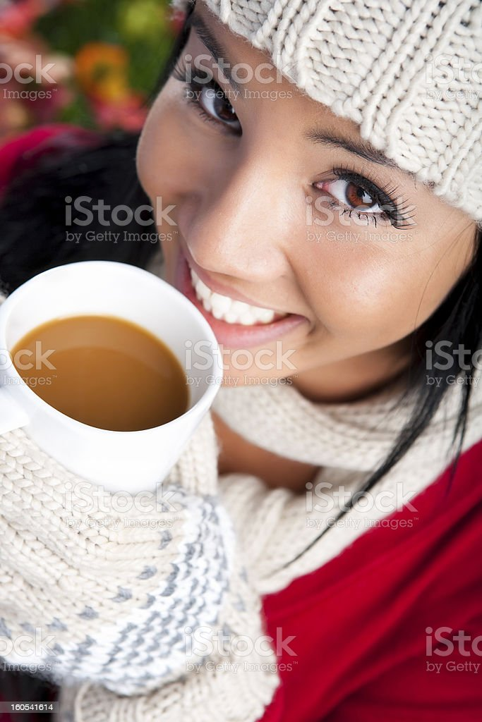 Autumn- Smiling woman drinking coffee royalty-free stock photo