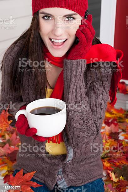 Photo of Autumn: Smiling young female talking on phone