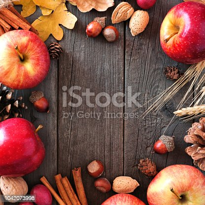 1020586746istockphoto Autumn square frame of apples and fall ingredients over wood 1042073998