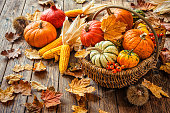 istock Autumn still life with pumpkins, corncobs and leaves 602333326