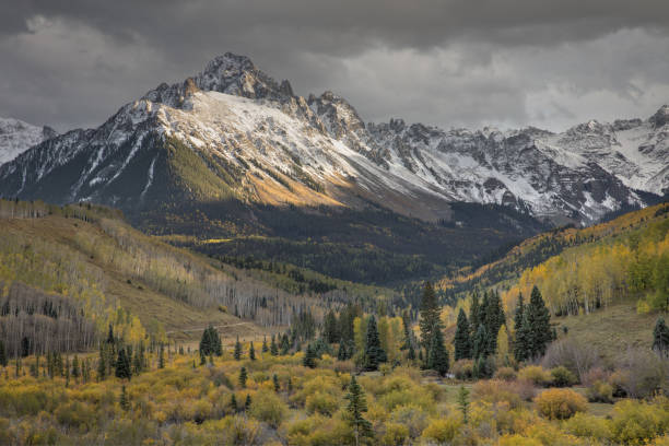 Autumn Storm over Mount Sneffels Taken late evening in the San Juan mountains near Ridgway, Colorado san juan mountains stock pictures, royalty-free photos & images