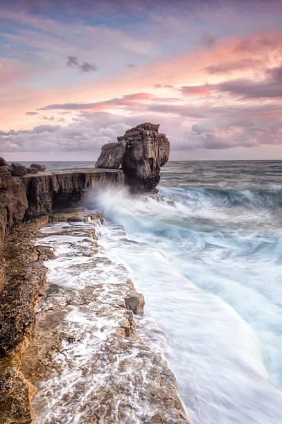 autumn storms at portland's pulpit rock - pulpit rock dorset stock photos and pictures