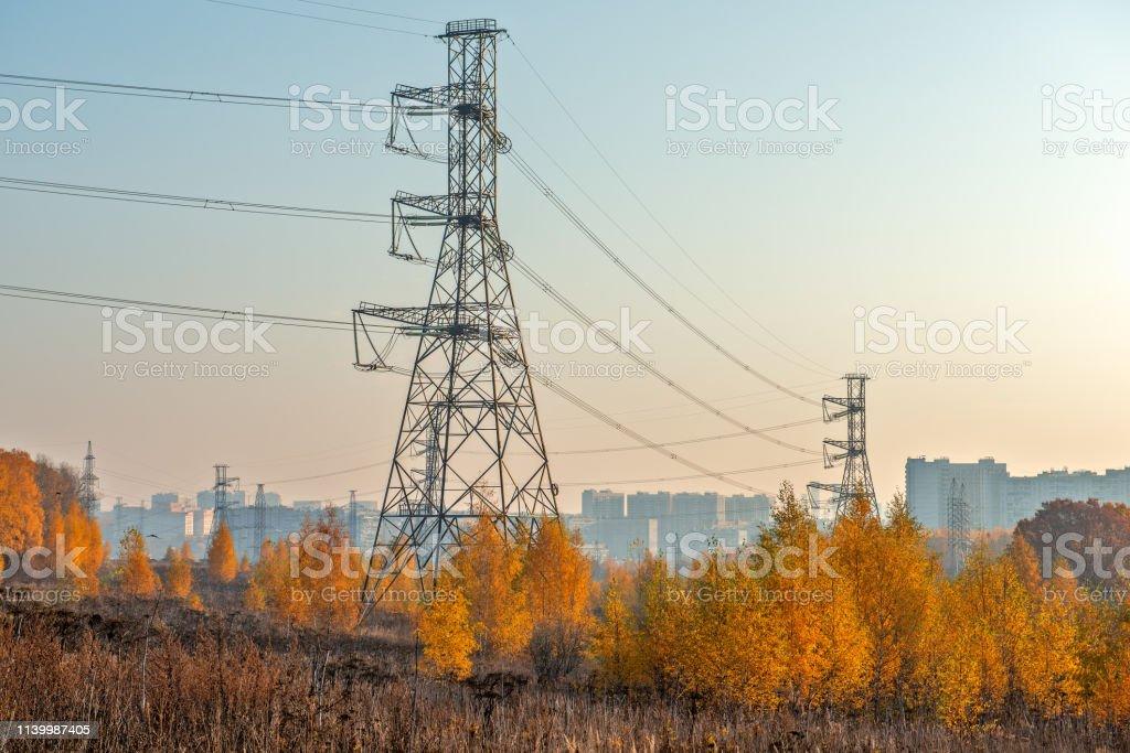 Autumn suburban landscape with power line stock photo