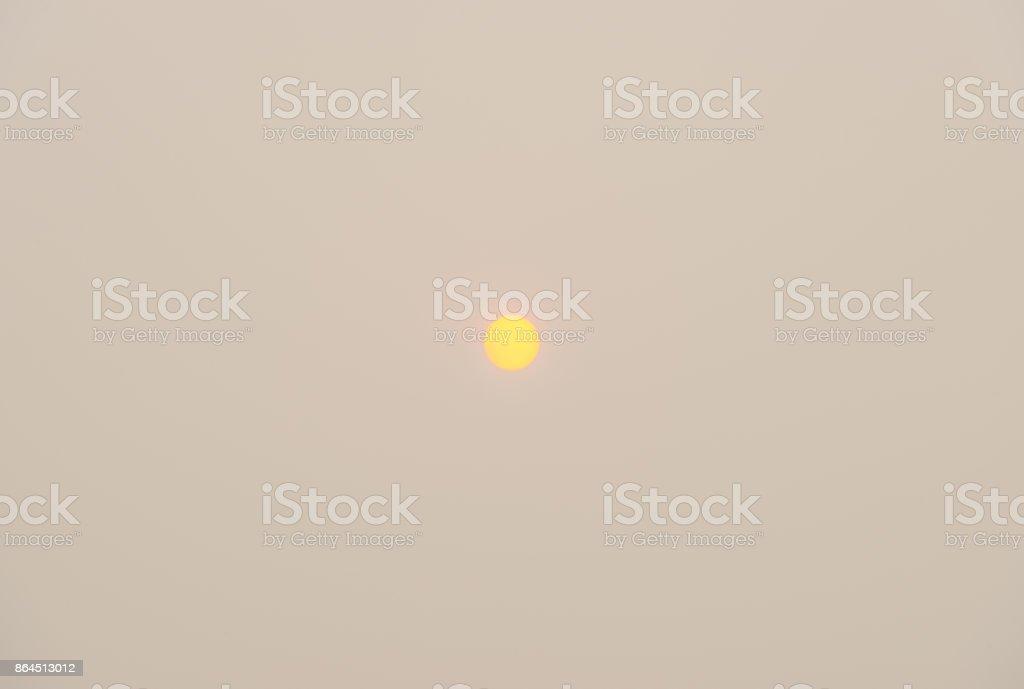 Autumn sun in a cloudy sky at fall stock photo