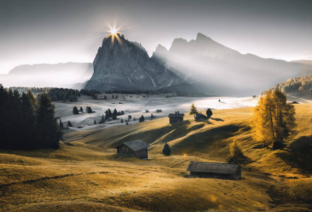 Autumn sunrise at Alpe di Siusi - Seiser Alm, Dolomites South Tyrol, Italy stock photo