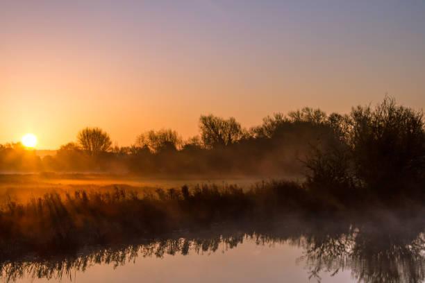 Autumn Sunrise Over the River Thames stock photo