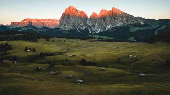 Alpe di Siusi sunrise with Sassolungo or Langkofel Mountain Group in Background