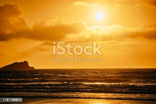 Autumn sunset over Fistral Beach, Newquay, Cornwall.
