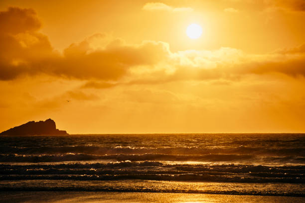 Autumn sunset over Fistral Beach, Newquay, Cornwall. stock photo